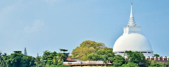 The magnificent Kalutara Bodhi Dagoba rises majestically on the bank of the Kalu Ganga