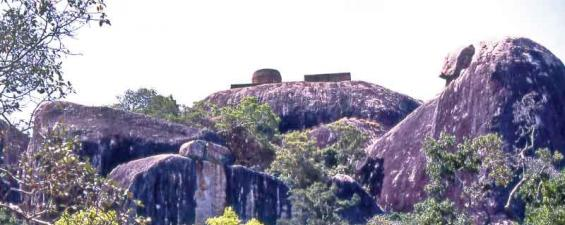 The main ancient dagoba on the summit of the lofty impressive rocky boulder of Kudumbigala forest hermitage in Bagura Lagoon in Panama