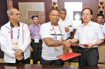 Suresh Subramaniam, president of the NOC of Sri Lanka, and his Chinese counterpart Gou Zhongwen  the Chinese Sports Minister signed a historic MOU which will help facilitate the development of local athletes to the next level. (Pic by Thusith Wijedhoru NOC media)
