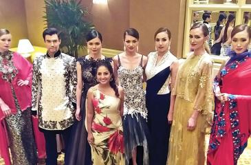 Kavita with her designs at a show in Singapore