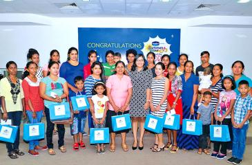 The 24 winners with their families and Vidhushi Rambukwella at the awards ceremony