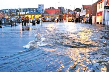 Streets were closed in Whitby after a tidal surge caused flooding on Friday evening Credit: Getty Images