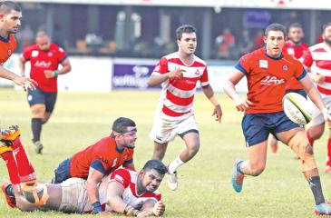 A CH&FC forward is tackled by CR flanker Sasanka Ariyaratne while CR number  8 Tariq Saleih is about to grab the loose ball in the Dialog 'A' division  second round rugby match played at Longden Place yesterday. (Pic by Thilak Perera)