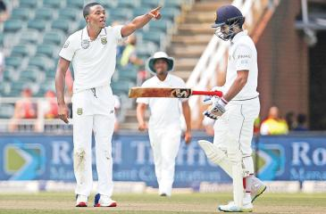 South African fast bowler Kagiso Rabada gestures as he celebrates bowling   out Sri Lanka opener Dimuth Karunaratne for 50 on the third day of the   third and final Test at Wanderers Stadium, Johannesburg on Saturday. AFP