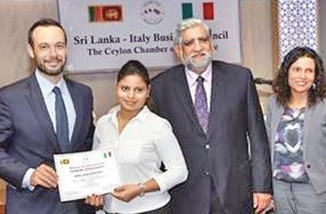 Imalka Maduwanthi of the third batch of the Italian Language Course receives her certificate from Dr. Giandomenico Milano.
