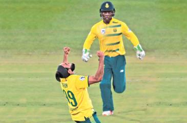 South African Imran Tahir (left) celebrates during the first T20 match between against Sri Lanka on January 20 at Supersport park in Centurion, South Africa. - AFP