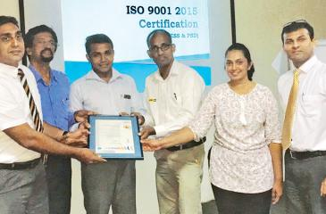 The UTE team with the ISO 9001:2015 certification. From left: CEO Riyad Ismail, Head of ESS and Ecologic Systems, Yasa Bandara, Manager ESS, Indika Thushara, Manager Power Systems, Ranil P. Maddepola, Six Sigma Black Belt, Dulika Rodrigo and Head of Six Sigma Division/Master Black Belt, Tharaka Dayabandara.