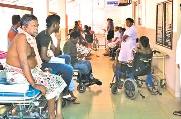 Patients from wards wait at the Dengue Unit for ultrasound scans at night, due to lack of beds inside
