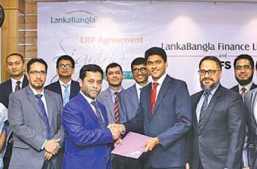Asanga Marasinghe, Country Director IFS Bangladesh handing over the agreement to Mohammed Nasir Uddin Chowdhury, Managing Director LankaBangla Finance Limited (LBFL) as Shiraz Lye, Director Sales & Marketing, IFS South-Asia, Zahid Khan, Head of Operations, IFS Bangladesh, Sheik Mohammad Fuad, Head of IT/LBFL, Khwaja Shahriar, Deputy Managing Director of LBFL, Shamim Al Mamun, Chief Financial Officer of LBFL, A. K. M. Kamruzzaman, Head of Operations of LBFL and other officials looks on