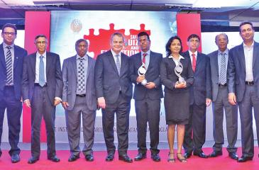 Ravindi Sandini and Hakeem Halwan with their awards. President of the International Accounting Standards Board (IASB), Hans Hoogervorst, President of CA Sri Lanka, Lasantha Wickremasinghe and Vice President Jagath Perera look on.