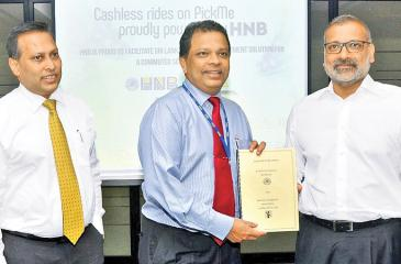 HNB and PickMe officials at the signing of the agreement.   PICTURE BY THUSHARA FERNANDO.