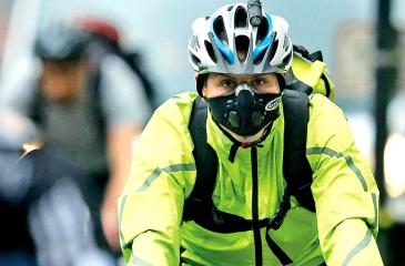 A London cyclist wears a face mask to avoid inhaling pollution  Getty Images