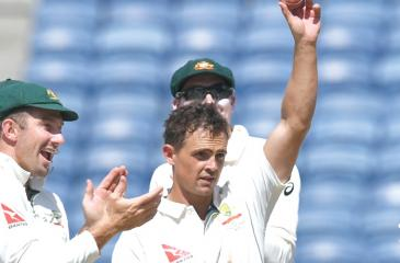 Australian spinner Steve O'Keefe holds the ball after taking six wickets in the Indian second innings on the third day of the first Test at Pune on Saturday. AFP