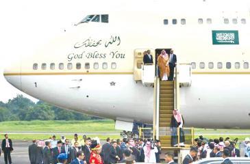 Saudi Arabia's King Salman bin Abdul Aziz (front) arrives at Halim airport in Jakarta