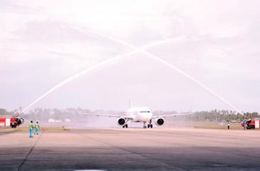 The new plane receives the traditional water salute