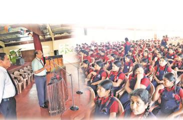 Principal Dr. Noel Vimalendran addresses schoolchildren