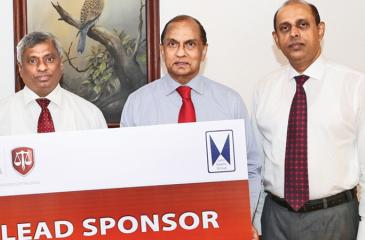 John Keells Holdings Group Finance Director Ronnie Peiris presents the lead sponsorship  cheque to CA Sri Lanka President Lasantha Wickremasinghe