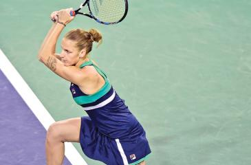 Karolina Pliskova watches the back hand shot she plays against Monica Puig in the Indian Wells championships on Saturday.  AFP