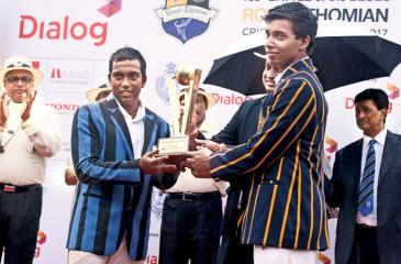 Rival captains Romesh Nallaperuma  (S Thomas' College) and Helitha Vithanage (Royal College) share the Dialog challenge trophy after the 138th Battle of the Blues cricket encounter had ended in a draw at the SSC grounds yesterday.