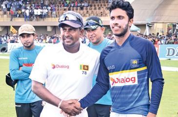 Rangana Herath congratulates Man of the Match  Kusal Mendis.    (Pix by Saman Mendis)