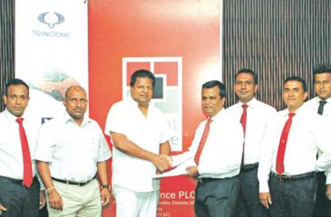 Ideal Automobiles (Pvt) Ltd team members along with Aravinda De Silva (Deputy Chairman –Ideal Automobiles), Nalin J. Welgama (chairman – Ideal Automobiles), Mayura Fernando (CEO of Orient Finance PLC), NilanthaJayanetti (Snr. AGM of Orient Finance PLC), and rest of the Orient Finance PLC Team.