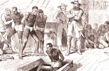 Photo by Ann Ronan Pictures/Print Collector/Getty Images Captives being brought on board a slave ship on the West Coast of Africa (Slave Coast), c1880. Although Britain outlawed slavery in 1833 and it was abolished in the USA after the defeat of the Confederacy in the Civil War in 1865, the transatlantic trade in African slaves continued. The main market for the slaves was Brazil, where slavery was not abolished until 1888.
