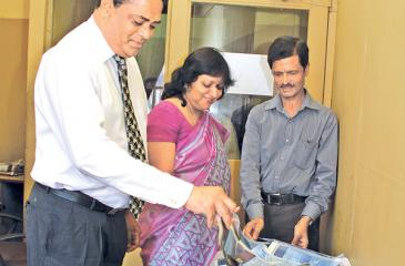 From left. Viraj Boise (DGM Finance),  Mrs.Kumudu Gunawardene (Company Secretary ANCL) and Jagath Hewapanna (Editor Mihira)  picking  the  lucky  reader's  coupon at  the  6th week  draw