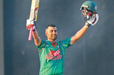 Bangladesh opener Tamim Iqbal celebrates his eighth century in the first ODI against Sri Lanka at the Rangiri Dambulla Stadium yesterday. PIc by Rukmal Gamage