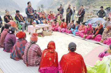 Berendina Group Chairman Anura Athapattu and Berendina's Enterprise Development Manager Rajesh Kanna discuss with rural women microfinance clients in Pyuthan, Nepal.