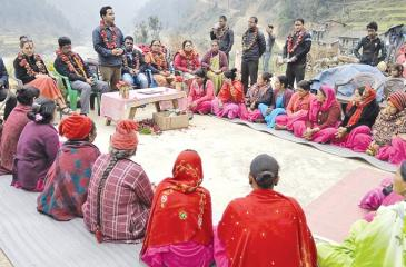 Berendina Group Chairman Anura Athapattu and Berendina's Enterprise Development Manager Rajesh Kanna discuss with rural women microfinance clients in Pyuthan, Nepal.