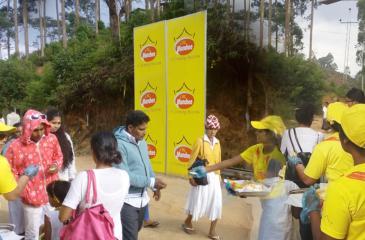 Munchee staff distribute biscuits