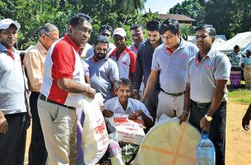 HelpAge officials distributing food items and household goods to victims