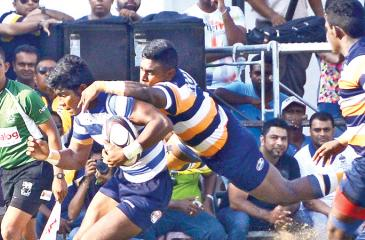 A Josephian player (ball in hand) is tackled by Peterite fly half Steffen Sivaraj in their schools rugby match played at Bambalapitiya yesterday. Pic by Saman Mendis