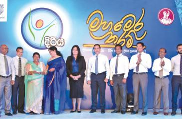 R. N. Ranjani (third from left) the Saubhagya entrepreneur who received the grand prize at the DiriyaPranama Awards on stage with the  chief guest, Malini Fonseka and representatives of the Samurdhi Authority, Unilever Sri Lanka and its partners.