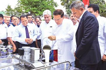 President Maithripala Sirisena at the opening of the dairy processing facility at Banduragoda. PIC: SUDATH MALAWEERA