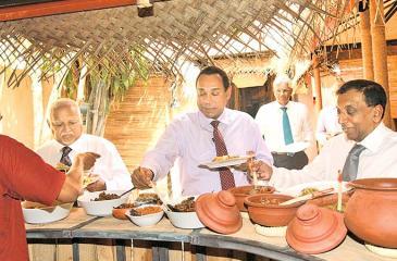 Harry Jayawardena, Niranjan Deva Aditiya, Sanath Ukwatte and Rajan Britto enjoy food at the launch