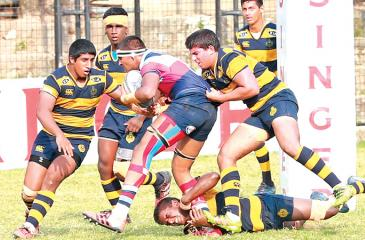(Pic Chinthaka Kumarasinghe) St.Anthony's College number eight Mohommed Shabeer (Ball in hand) making a break