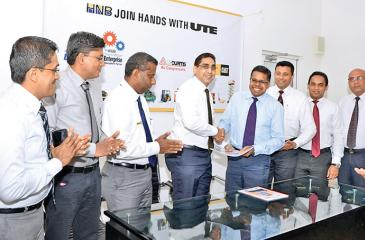 Exchange of the MoU. From left: Marketing Consultant, Michael Ranasinghe, Manager, Industrial Solutions, Sampath Sudarshana, General Manager, Power Systems/Material Handling Solutions /Industrial Solutions and Energy Solutions, ManjulaVithanage, CEO of UTE, Riyad Ismail, COO, HNB, Dilshan Rodrigo, Senior Manager, Personal Financial Services, Kanchana Karunagama, Senior Manager, SME Business Division, Niluka Amarasinghe, and Senior Manager, Leasing, HNB, Jeewantha Perera.