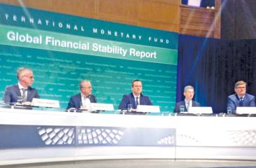 IMF Financial Counsellor Tobias Adrian (third from left) addresses the media.