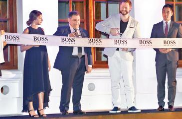 From left: Ms. Tanaz Pestonjee - Director, Tito Pestonjee - Managing Director - ABANS PLC, Matthew Keighran - Managing Director - HUGO BOSS South East Asia - Far East Asia and Oceania, and Steven Lam - Managing Director - HUGO BOSS South East Asia formally opening the new BOSS Store.