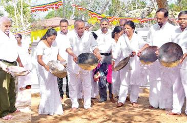 BOC Chairman Ronald C. Perera and staff take part in the  sand strewing ceremony