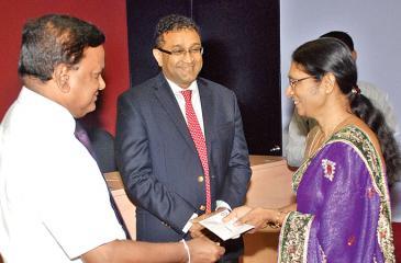 BOI Chairman Upul Jayasuriya makes a presentation to an employee
