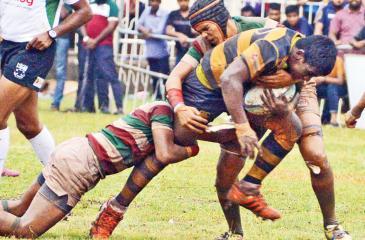 A Royal player tackled by a Zahirian. Royal beat Zahira 65-14 at Maradana yesterday