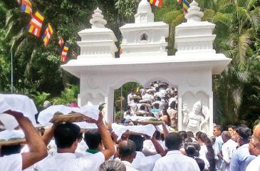 Tea producers wend their way to the Sacred Getabaru Raja Maha Viharaya in Kotapola