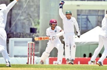 Pakistan wicket keeper Sarfraz Ahmed successfully appeals against Kraigg Brathwaite. - Dawn