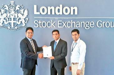 An LSEG official receives the certification