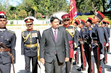 Chief Guest, State Minister of Defence Ruwan Wijewardene, and Army Commander Lt. General Chrishanthe de Silva at the parade
