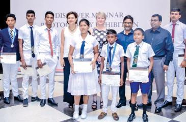 Award winners from the Student Category : (Back Row – from Left: Ajith Ratnayaka, Managing Director of the Palmyrah House; Heshan Kaushalya – Silver, S. Cavinsan – Merit; Vijayakumaran Thivakar – Merit; Amena Arif, IFC Country Manager for Sri Lanka and Maldives; Libuse Soukupova, Head of Cooperation of the EU Delegation to Sri Lanka and the Maldives; Hiran Weliwitigoda, President of the Photographic Society of Sri Lanka; Mr. Thayanathan, Director, Palmyrah House; A. Antoneyo Anastan – Merit; Akshay Sattruka