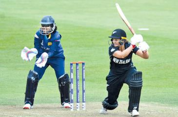 New Zealand's Suzi Bates who scored an unbeaten century drives for runs on the off side watched by Sri Lanka wicket-keeper Prasadani Weerakkody in their ICC Women's World Cup match played at Bristol on Saturday.