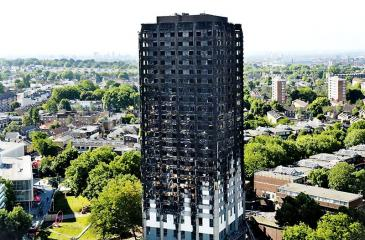 The remains of Grenfell Tower, a residential tower block in west London which was gutted by fire, are pictured against the London skyline on June 16, 2017. The toll from the London tower block fire has risen to at least 30 people dead and the flames have now been extinguished, police said .  CHRIS J RATCLIFFE/AFP/Getty Images)